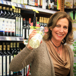 Beth Greer holding a bottle of white vinegar at the store