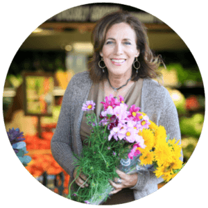 Beth Greer holding flowers at the Farmer's Market